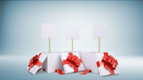 Three blank paper sheets popped out of three gift Royalty Free Stock Image