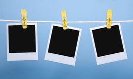 Three blank photo cards isolated on blue background Stock Photography