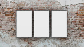 Three blank photo frames on brick wall 3d render Royalty Free Stock Photos