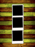 Three Blank Photos on Colorful Wooden Backgroun. Three empty polaroids on multi-colored wood planks background. A great frame for your images. Please visit my Stock Images