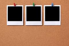Three blank polaroid frame photo prints cork background copy space Stock Photography
