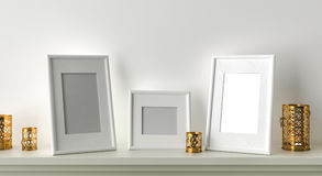 Three blank picture frame with candles on fireplace. 3D render stock illustration