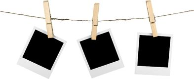 Three Blank Polaroid Frames Hanging on Twine. Colorful paper space business empty equipment board Royalty Free Stock Photography
