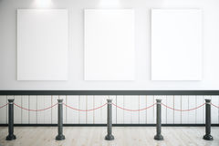 Three blank posters in museum Stock Photos