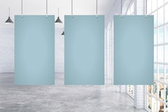 Three blank posters in room Royalty Free Stock Photography