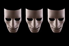 Three blank robot faces on a black background stock photos