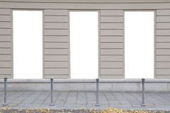 Three blank vertical mockups of light boxes on a building wall. Autumn street. Front view Stock Image