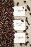 Three blank white card  on textile and coffee beans  background Royalty Free Stock Photography