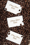 Three blank white card  for your text  on coffee beans  backgrou Royalty Free Stock Photos
