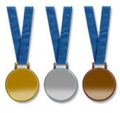 Three blank winners medals. Three winners medals hanging from ribbon. Gold, silver and bronze. The medals are left blank to enable text to be added. Isolated on Royalty Free Stock Images