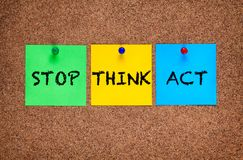 Three blanks post-it notes on corkboard with words Stop, Think, Act. Three blanks post-it notes on cork board with words Stop, Think, Act stock image