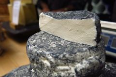 Blocks of cheese stacked at market Stock Photos