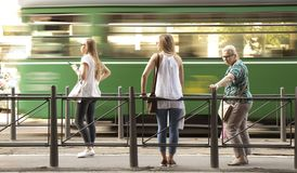 Three blond  women standing at a bus stop and waiting for publi. Belgrade, Serbia - June 1, 2018 : Three blond  women standing at a bus stop and waiting for Royalty Free Stock Photography