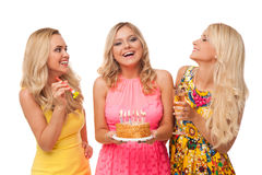 Three blonde girls celebration birthday with cake and champagne Royalty Free Stock Photos