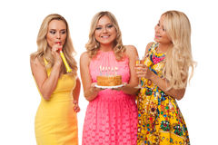 Three blonde girls celebration birthday with cake and champagne Stock Photos