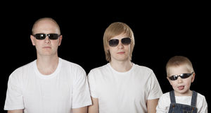 Three blonde males in sunglasses over black Stock Images