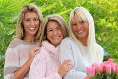 Three blonde mature woman Stock Images