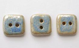 Three blue buttons stock photos