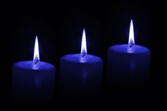 Three blue candles Stock Photo