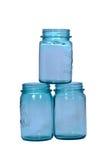 Three blue canning jars. Isolated on white royalty free stock image