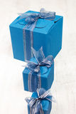 Three blue carton gift boxes in a row Stock Photos