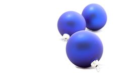 Three blue christmas balls. A three blue christmas balls isolated on white background Stock Image