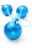 Three blue Christmas balls, close-up, isolated on white Royalty Free Stock Photography