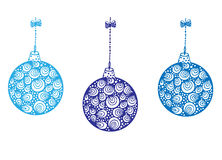 Three blue Christmas balls hanging on ribbon. White background Royalty Free Stock Photos