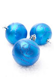 Three blue Christmas balls on snow. On white Royalty Free Stock Images