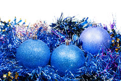 Three blue Christmas balls and tinsel isolated Stock Photo