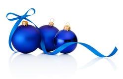 Three blue Christmas baubles on white background. Three blue Christmas baubles on a white background stock photos