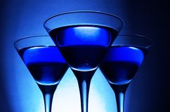 Three blue cocktails c stock photography