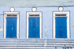 Three Blue Doors on Blue Building Royalty Free Stock Photography
