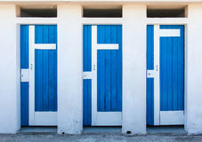 Three blue doors. Next to each other Stock Images