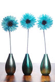 Three blue flowers. In vases on a white background stock images