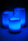 Three blue LED candles. In the dark Royalty Free Stock Photos