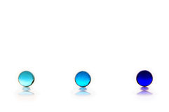 Three Blue Marbles. Ranging from light to dark blue, on a white background Royalty Free Stock Images