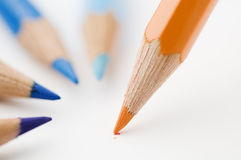 Three blue and one orange pencils Stock Photo