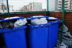 Three blue plastic garbage Royalty Free Stock Images