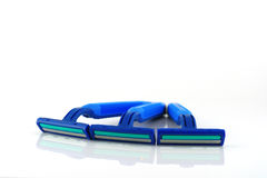 Three blue razors over white Royalty Free Stock Images