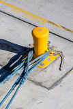 Three Blue Ropes on Yellow Bollard Royalty Free Stock Images