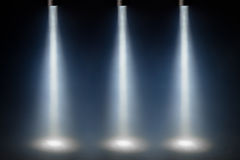 Three blue spot lights. On stage stock image
