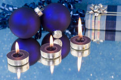 Three blue tealights with baubles Royalty Free Stock Image