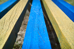 Three blue and two yellow planks Royalty Free Stock Images