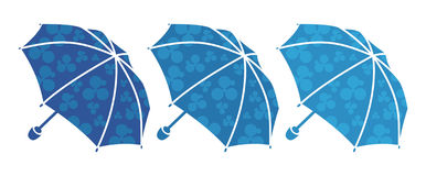 Three blue umbrellas Royalty Free Stock Photo