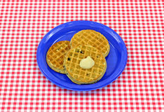 Three blueberry waffles on plate Stock Image