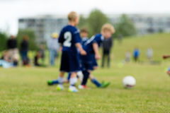 Three blurred soccer kids Stock Images