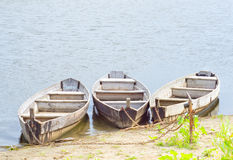 Three boats. On coast of the river stock photo