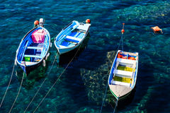 Three Boats Anchored near Riomaggiore Royalty Free Stock Photography