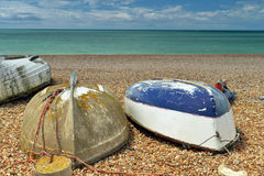 Three boats on the beach upside-down Royalty Free Stock Photo